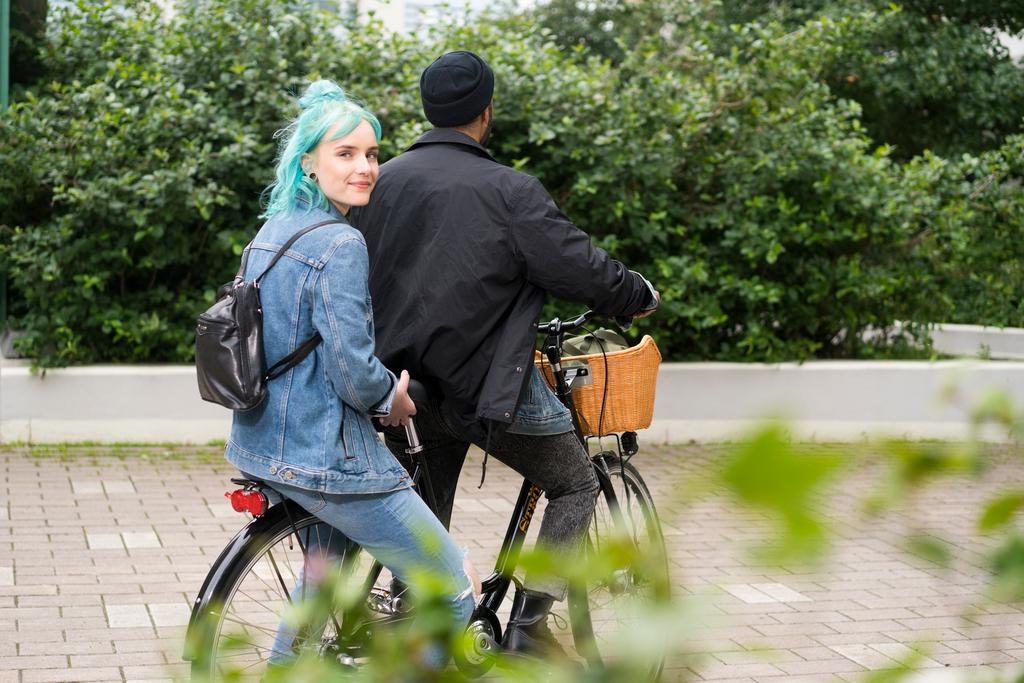 Teenagers with a bike.