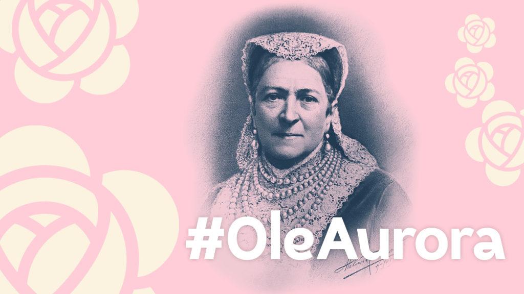 Vaalenapunainen tausa, jossa kuva Aurora Karamzinista. Kuvassa on teksti Ole Aurora.